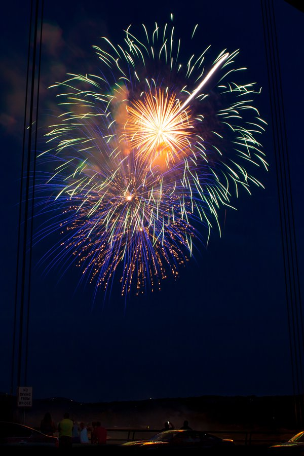 A single frame of spectators watching fireworks from a bridge in Austin, Texas. thumbnail