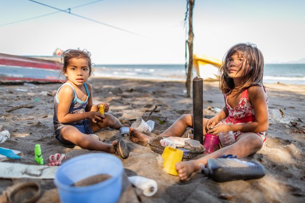Girls playing with trash on a beach in Nicaragua thumbnail