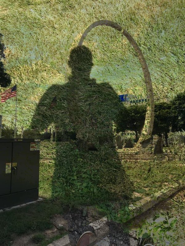 My shadow in grass with the labor legacy in background thumbnail