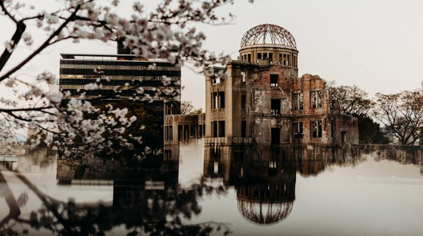 Atomic Bomb Dome Surrounded By Cherry Blossoms thumbnail