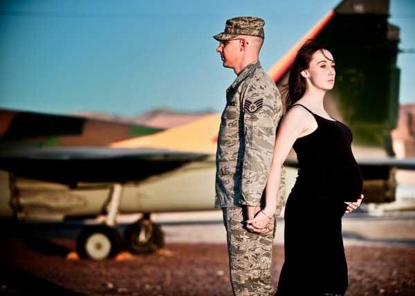 An airforce officer and his expecting wife. thumbnail