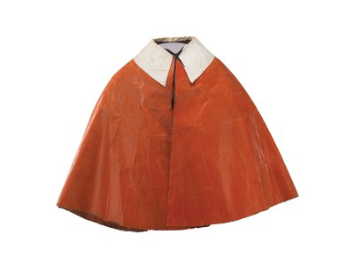 An oil-cloth cape worn by a young Republican during a late-night, torch-lit campaign march ahead of the 1880 presidential election.