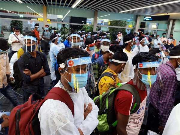 Air Asia passengers wearing face shields and face masks await boarding thumbnail