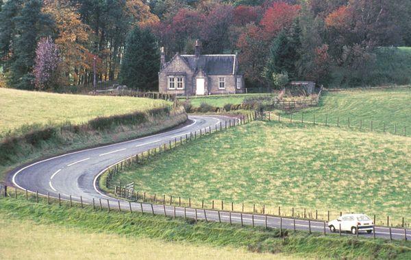 A car travels along a winding English road thumbnail