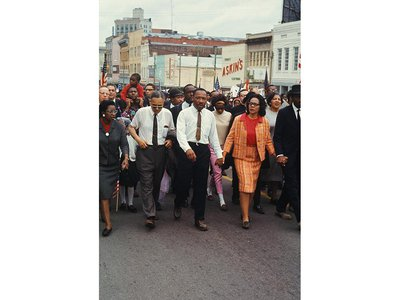 King led a throng of 25,000 marchers through downtown Montgomery in 1965.