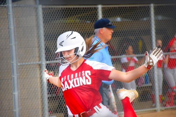 FHS Softball player gliding to home base thumbnail