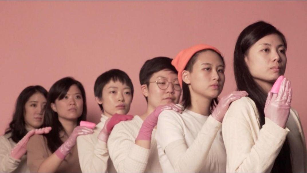 A still from a video of six women standing