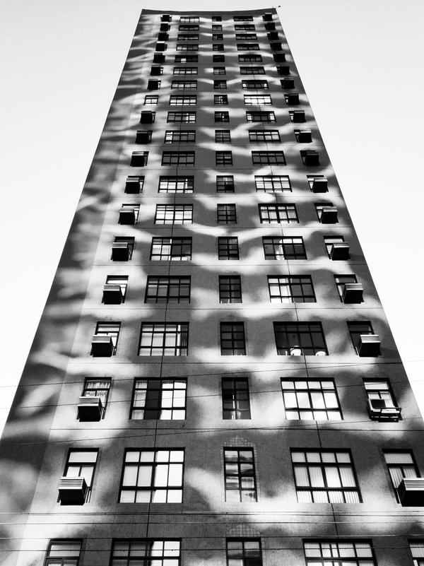 A strange and attractive pattern of reflections on the facade of a building. thumbnail