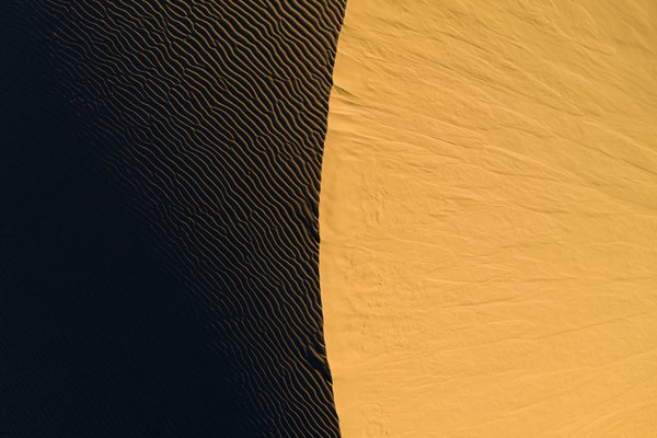 An abstract aerial view of a sand dune at sunset. thumbnail