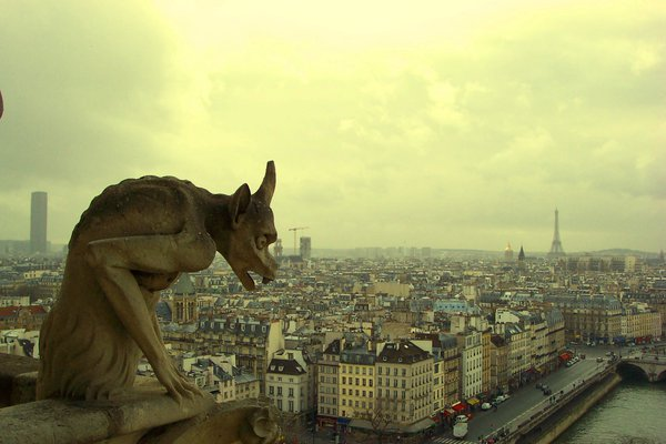 Gargoil looking out over Paris from on top Notre Dame thumbnail