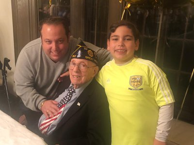 Philip Kahn, pictured on his 100th birthday with his grandson, Warren Zysman, and great-grandson