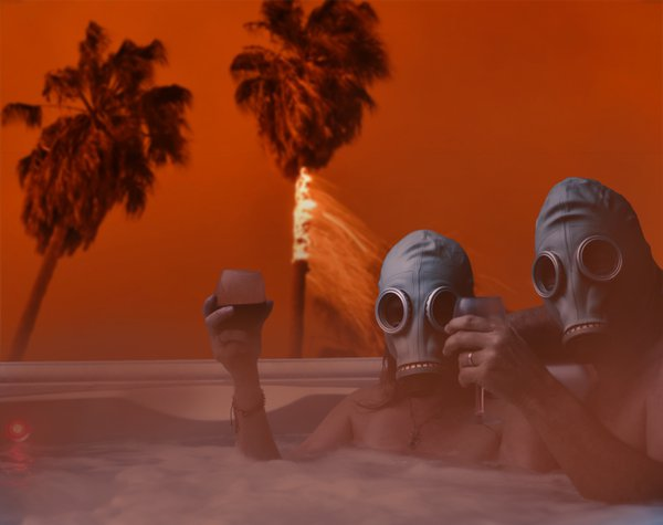 California Dreaming: A shot of me and my wife in our backyard hot tub combined with a photo of palm trees burning. thumbnail