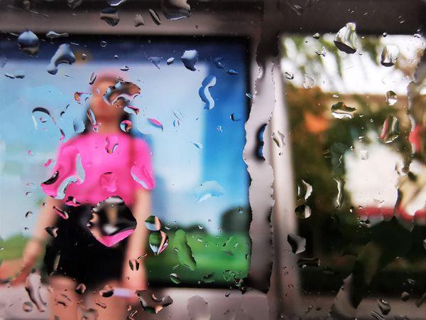Bus stop in a summer rain thumbnail