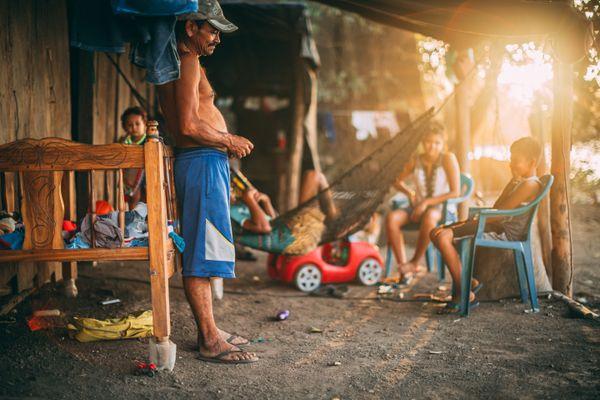 Fisherman's family at sunset thumbnail