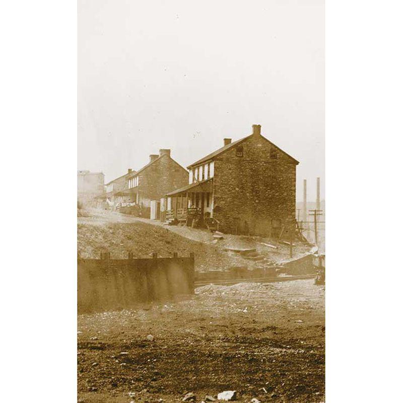 Sepia photo of company mill housing