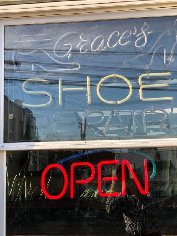 A shoe repair shop with neon. thumbnail