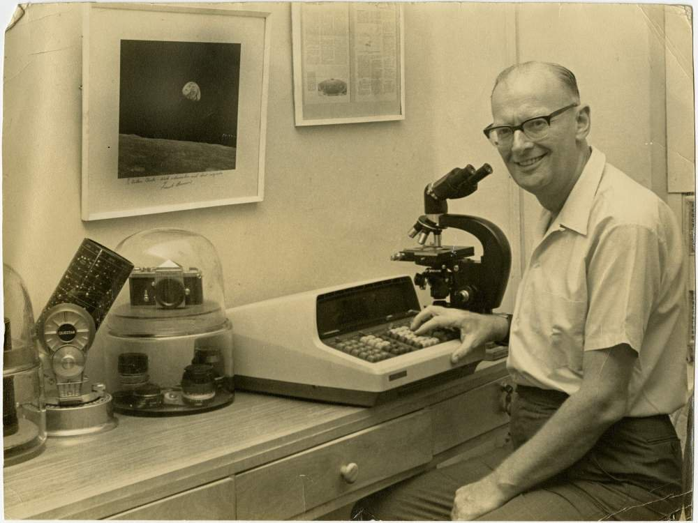 Arthur C. Clarke poses for a photo while he sits at his desk, circa 1969.