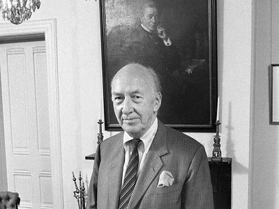 Smithsonian Secretary S. Dillon Ripley, in 1978, stands before a portrait of a predecessor—Joseph Henry, the first Secretary.