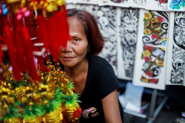A woman sells Chinese ornaments at Chinatown thumbnail