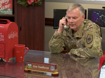 Gen. Glen VanHerck, Commander of North American Aerospace Defense Command and U.S. Northern Command talks on the phone as part of a video celebrating the NORAD Santa Tracker's 65th year.