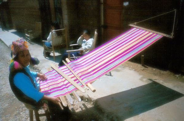 A Quechua man weaving multicolored cloth. Peruvians are famous for their weaving. thumbnail