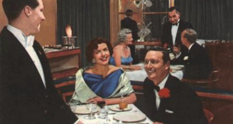 Dining aboard the RMS Caronia, from a 1950s World Cruise brochure.