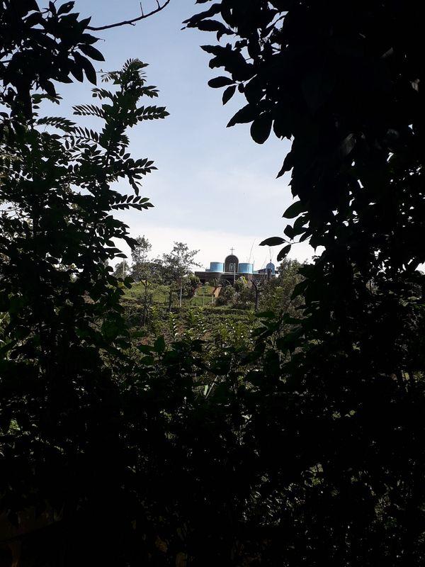 A CATHOLIC CHURCH nestled on a cliff thumbnail
