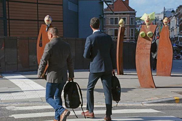 men looking at sculptures thumbnail