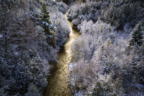 Winter scene of the first snow fall in the river valley. thumbnail