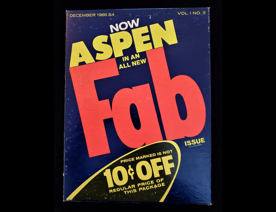 """Magazine cover with """"Fab"""" printed in large orange letters in center. Yellow """"Aspen"""" directly above."""