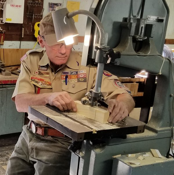 A Boy Scout Leader Carves A Cub Scout's Pinewood Derby Racecar thumbnail
