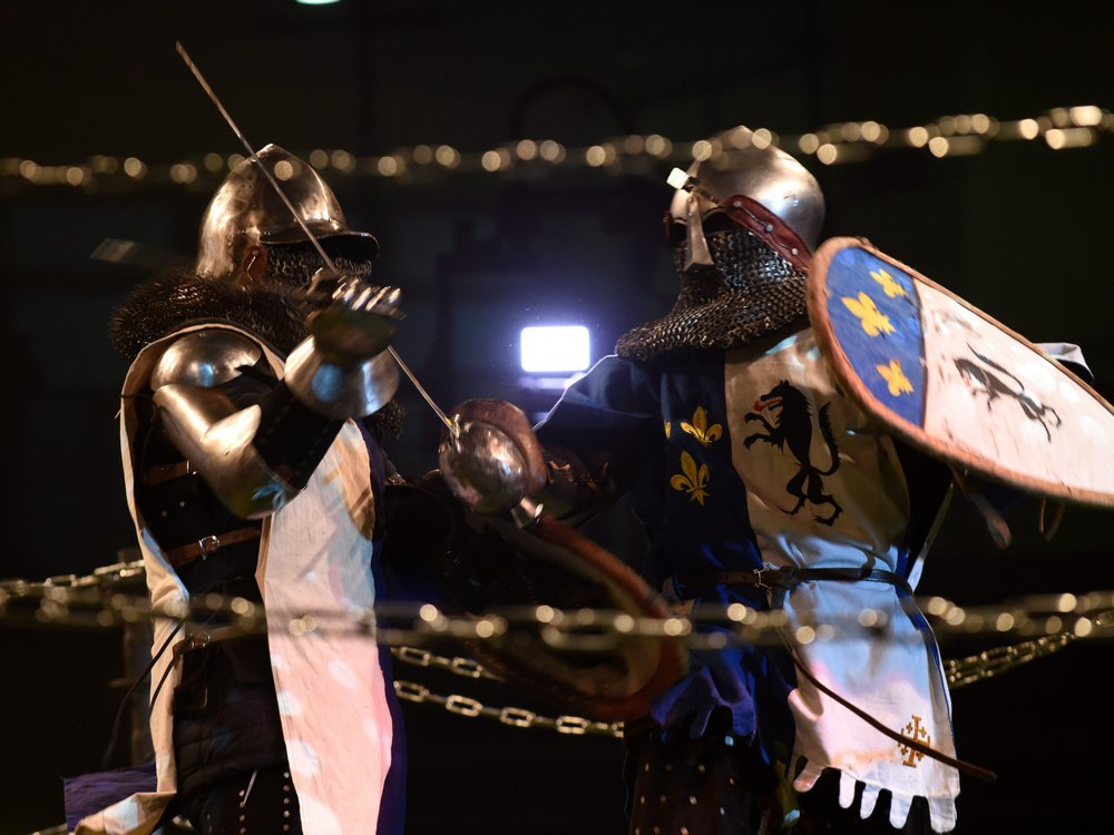 Men are fighting during a Medieval fighting championship