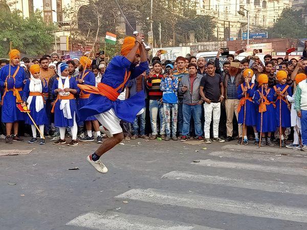 A Nihang Sikh displaying martial art skills. thumbnail