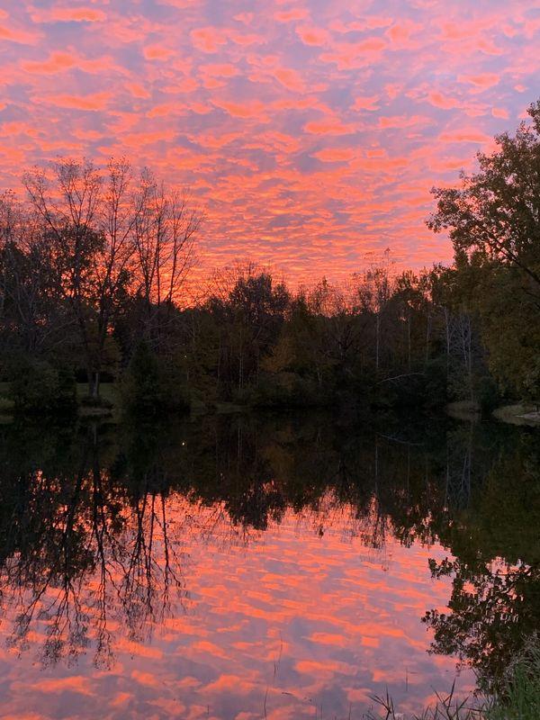 Reflection of the sunrise over lake thumbnail