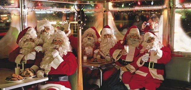 Santa Clauses Eating Milk and Cookies