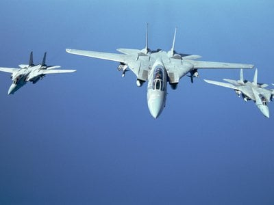 Three F-14 Tomcats fly in a tight formation over the Red Sea during Operation Desert Storm. The F-14s primary function was to intercept multiple airborne threats in all weather conditions and at night.