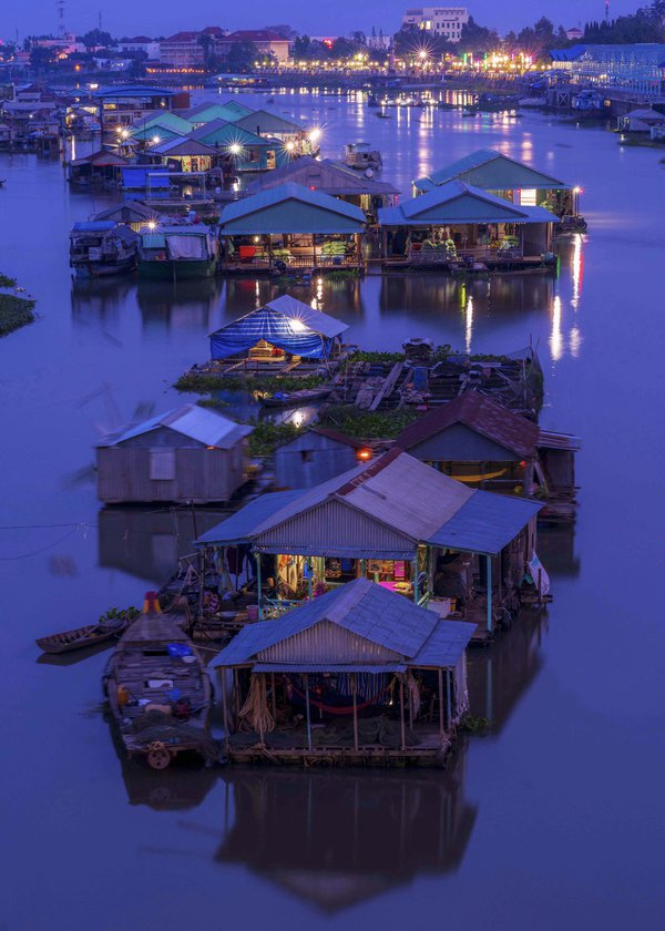 Floating house village in night thumbnail