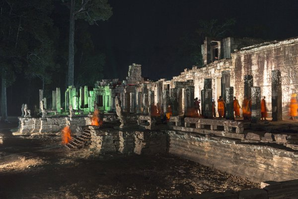 Buddhist monks at Bayon temple at night during the Khmer New Year celebration thumbnail