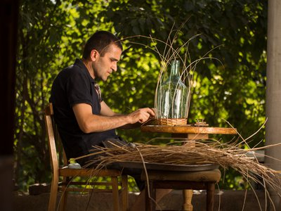Master basket weaver Arthur Petrosyan sits and works on a project. (Photo by Narek Harutyunyan, My Armenia Program)