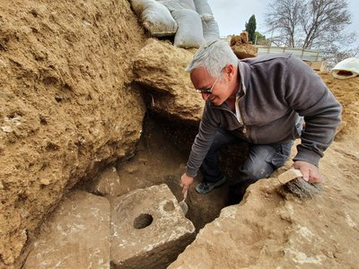 A cubicle surrounding the toilet and a deep septic tank beneath it were both carved out of limestone bedrock.