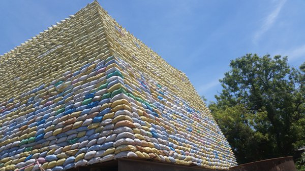 Cement bags stacked in a pyramid shape in India thumbnail