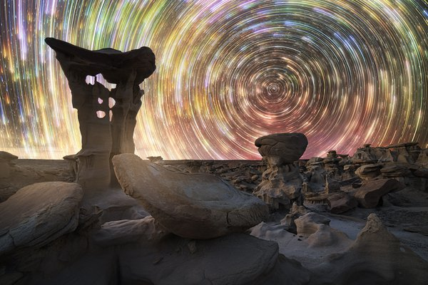 Star trails over the Alien Throne formation in New Mexico's Bisti Wilderness Area,