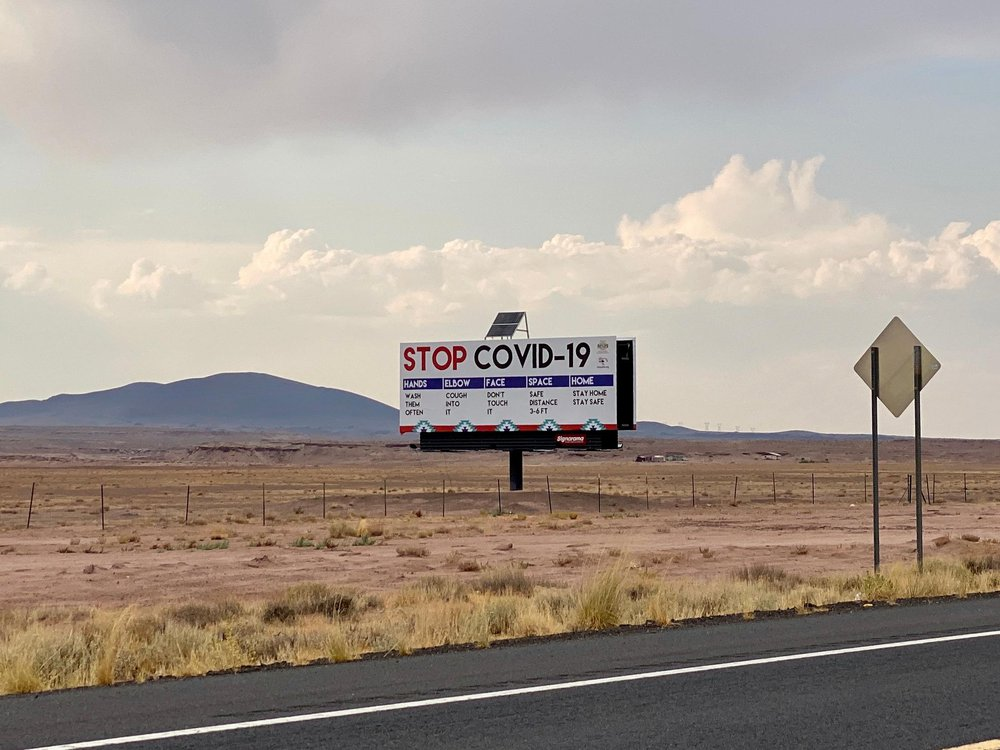 """A billboard that reads """"STOP COVID-19"""" stands out in the desert along Route 89 in Arizona"""