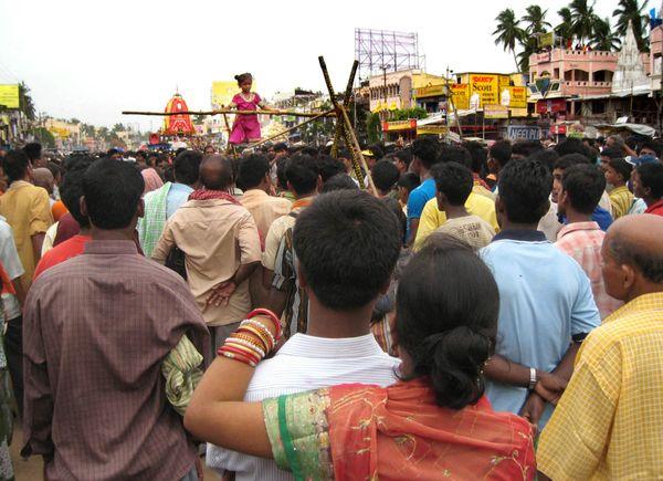 Roadside jugglers are entertaining the visitors at Rathayatra festival. thumbnail